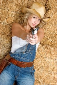 Blonde in overalls with a gun